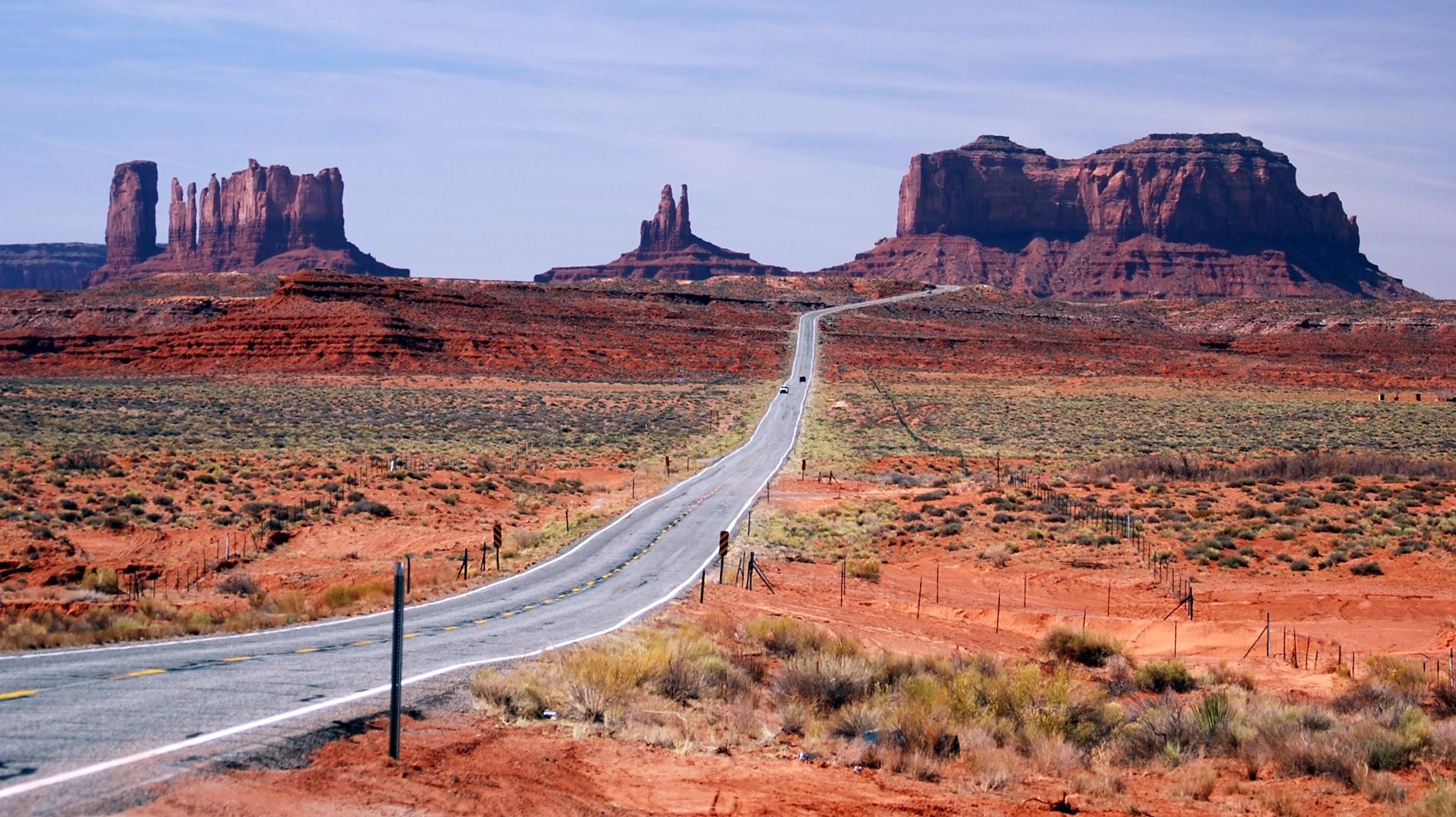 Car Driving Through Desert